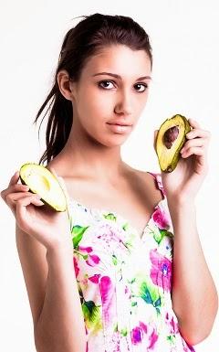 brunette-holding-two-avocado-halves