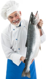chef-holding-a-fresh-salmon-176x300
