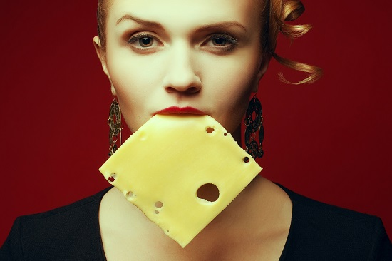 woman-with-a-slice-of-cheese-in-mouth