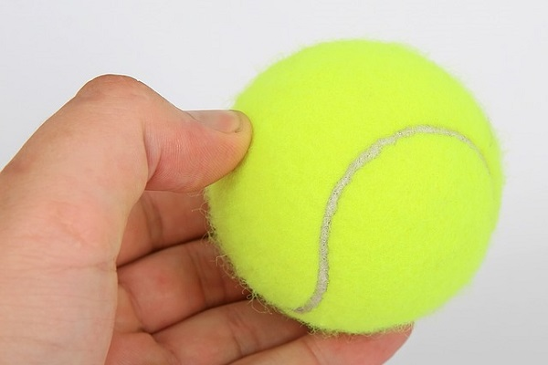 Exercising with a tennis ball may help relieve sciatic nerve pain caused by muscle tension.